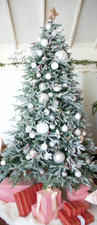 simple rustic cottage decorated and flocked artificial Christmas tree