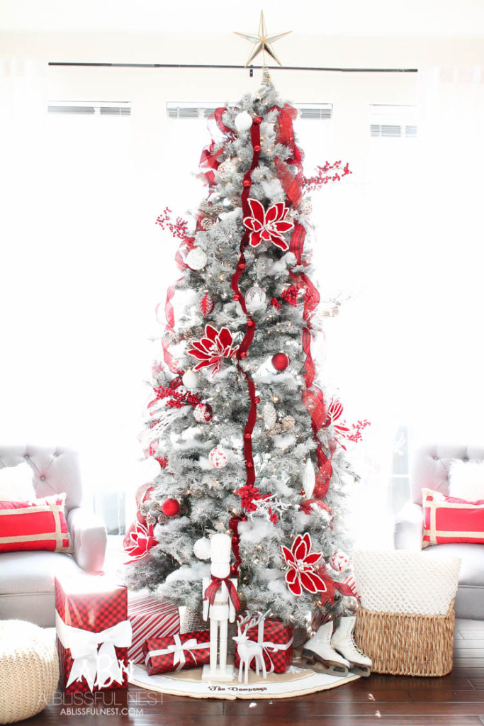 red and white decorated slim christmas tree